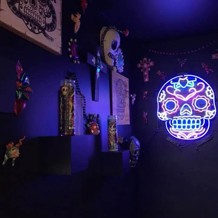High Rollers Tattoo Studio Interior - Day of the Dead Artwork